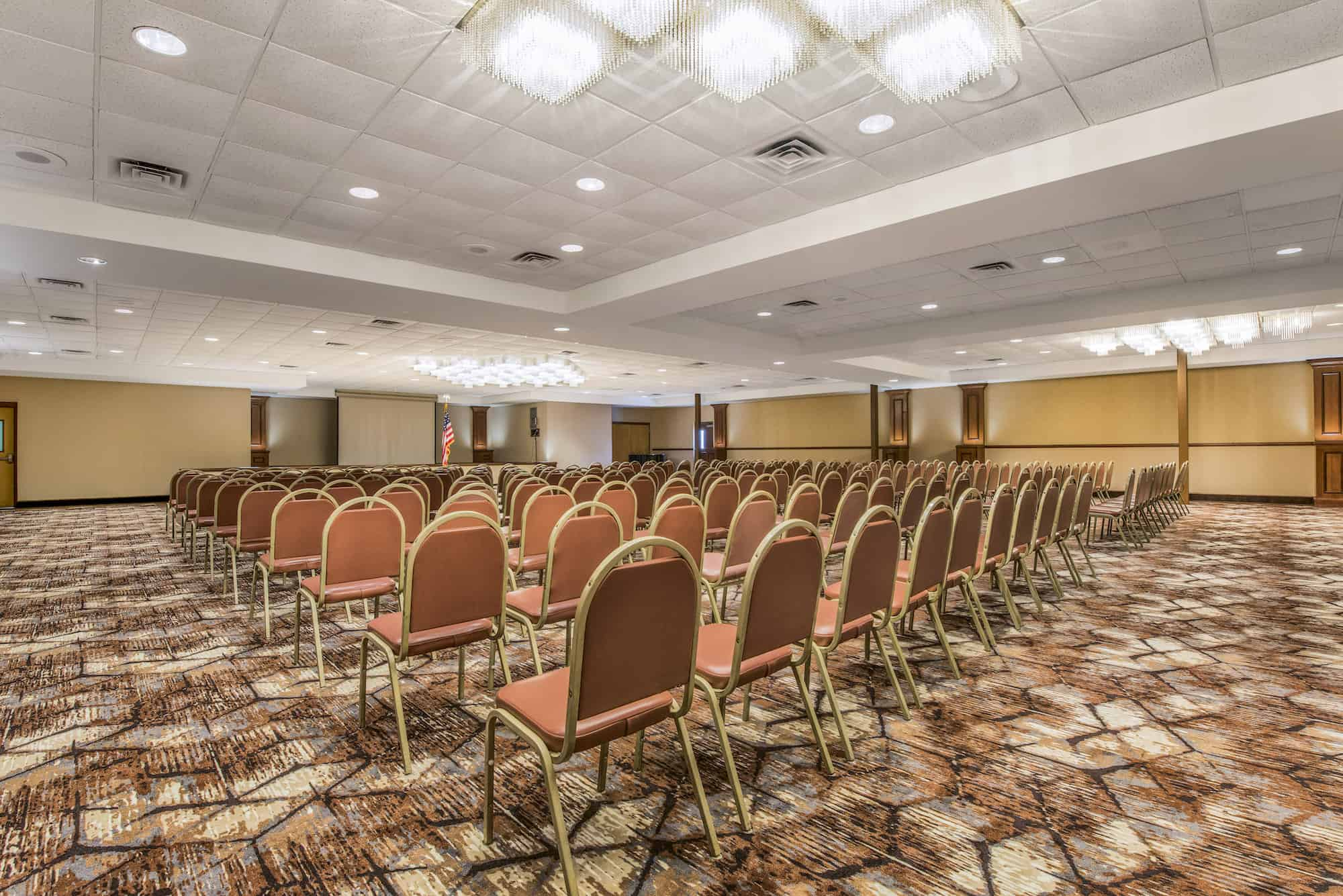 Large conference room with rows a chairs