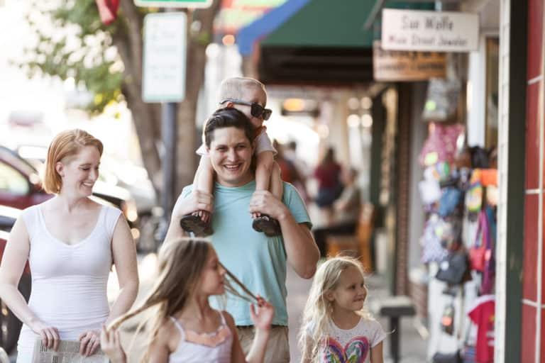 A family walking down a sidewalk