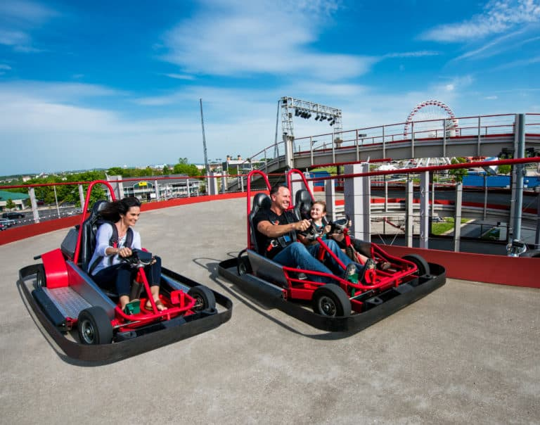 Two go-karts racings around multi level track