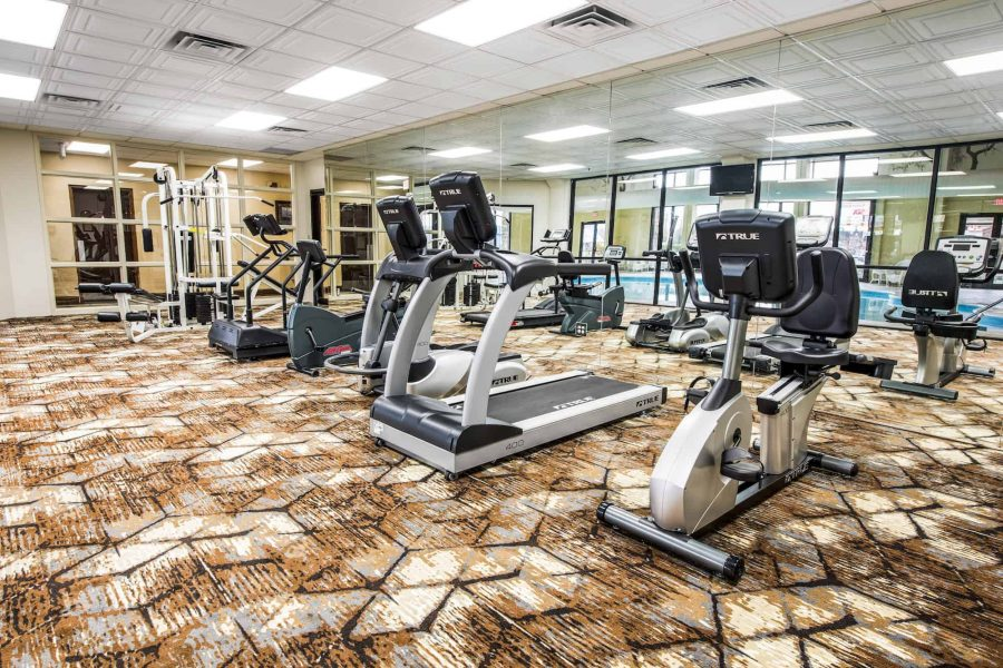 Hotel workout room with various gym equipment